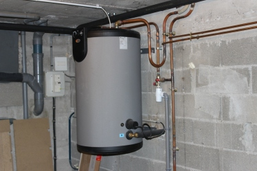 Ballon d'eau chaude mixte, avec deux utilisations possibles : chaudière et électricité